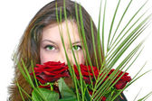 Girl with a bouquet of roses — Stock Photo