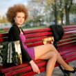 Portrait of a girl in the park after shopping — Stockfoto