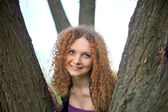 Portrait of a pretty girl in the trees — Stock Photo