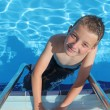 Boy enjoying a dip in the pool — Stock Photo #10353180