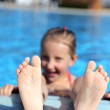 Girl swimming in the pool for a long time — Stock Photo #10353277