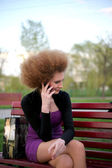 Talking on the phone the girl in the park — Stock Photo