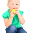 Child with an appetite for eating an apple — Stock Photo #10521933