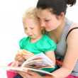 Nurse the child reads a book — Stock Photo