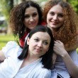Portrait of three girls posing in the park — Stock Photo