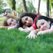 Three girls on the grass — Stock Photo