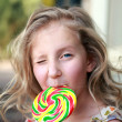 Royalty-Free Stock Photo: Girl with a big candy