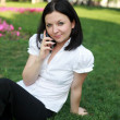 Brunette with a phone — Stock Photo