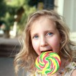 Royalty-Free Stock Photo: A child with a huge sweet