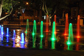 Color fountain in night city — Stock Photo