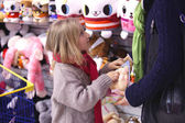 Persuaded to purchase toys — ストック写真