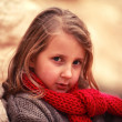 Child in a red scarf — Stok fotoğraf