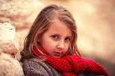 Child in a red scarf — Stock Photo