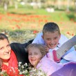 Mom with son and daughter in the park fooled — Stock Photo