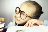 Girl with big glasses thought — Stock Photo