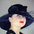 Glamorous woman in the hat — Stock Photo