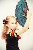 Girl dancer with a fan — Stock Photo