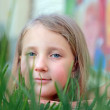 Portrait of a girl in the grass — Stock Photo #9897057