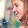 Girl playing with water — Stock Photo #9924342