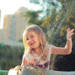 Girl near the fountain — Stock Photo