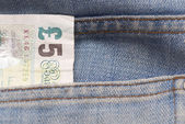 Five Pound Note in Jeans Pocket. — Stock Photo