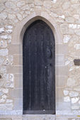 Medieval Black Church Door. — Stock Photo