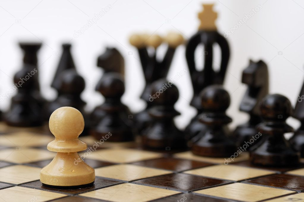 One pawn standing up to a stronger opponent. — Stock Photo #8713837