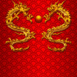 Pair of Chinese Dragons on Scale Pattern Background — Stock Photo #8301300