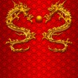 Pair of Chinese Dragons on Scale Pattern Background — Stock Photo