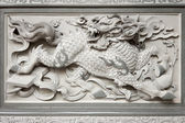 Stone Carving of Qilin on Chinese Temple Wall — Stock Photo