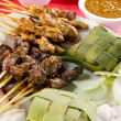 Chicken and Lamb Satay Skewers with Ketupat Rice - Stock Photo
