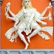 Hindu Goddess with Many Arms Temple Statue - Stock Photo
