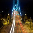 Stock Photo: Light Trails on Lions Gate Bridge at Night