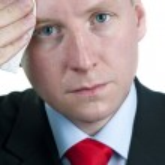 Sweaty Businessman Wiping Forehead — Stock Photo #8064285
