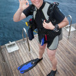 Scuba diver showing ok sign — Stock Photo