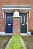 Similar but different entrance door — Stock Photo