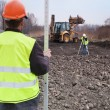 Building a road - Surveyors at work — Stock Photo