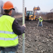 Foto Stock: Building road - Surveyors at work