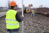 Construction d'une route - géomètres au travail — Photo