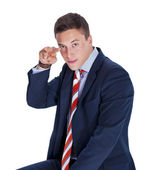 Serious businessman pointing fingers — Stock Photo