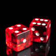 Red dice on transparent black background — Stock Photo