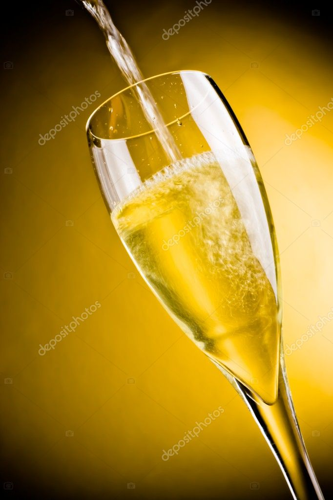 End of filling a champagne glass on golden background with space for text  Stock Photo #8021755
