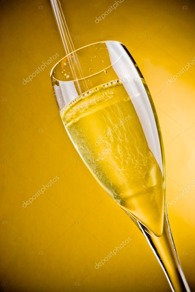 End of filling a champagne glass on golden background with space for text — Stock Photo #8126867
