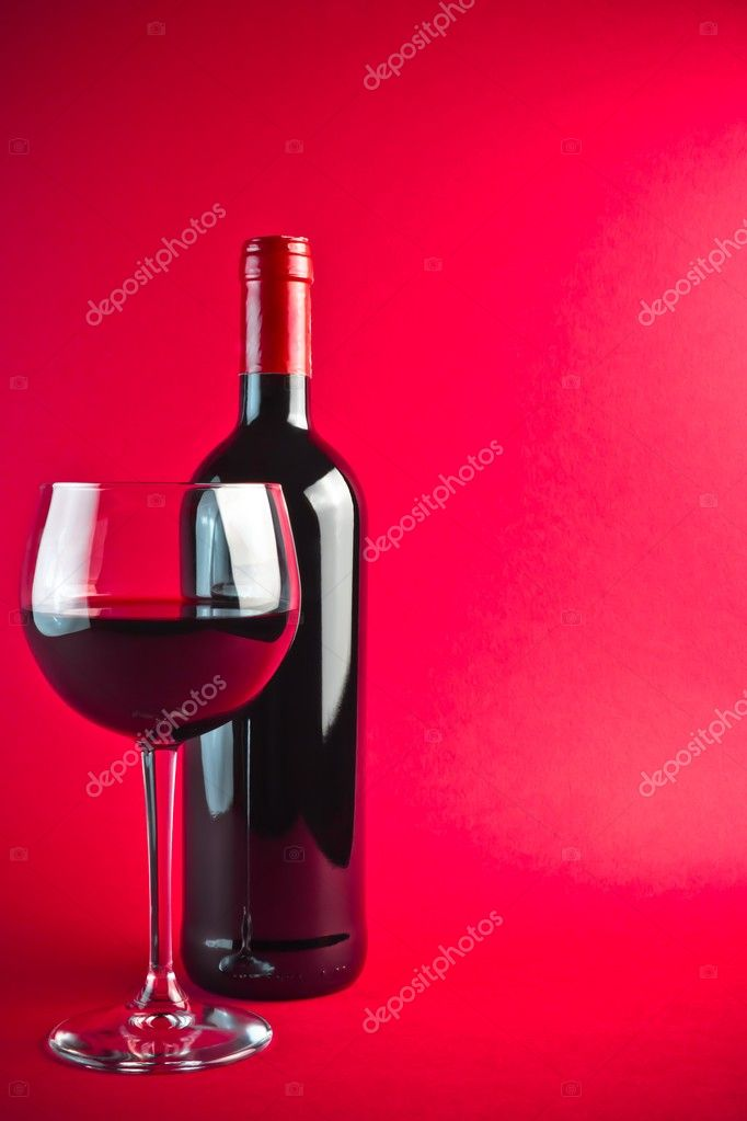 Bottle with red wine and glass on red background — Stock Photo #8485906