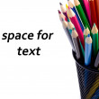 Stack of colour pencils inside the container on white background — Stock Photo