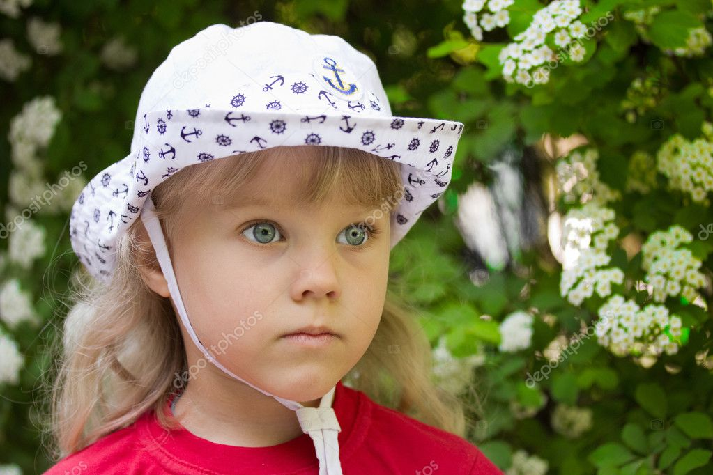 Little serious girl in a white cap — Stock Photo #10647549
