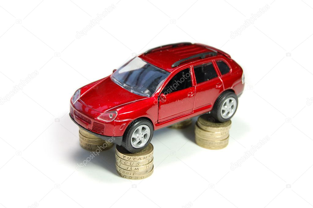 Toy car on top of stacks of coins — Stock Photo #8638320