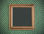 Picture frame on vintage wallpaper — Stock Photo