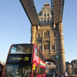 Bus Crossing Tower Bridge in London - Stock Photo