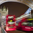 Buses Crossing Tower Bridge in London - Stock Photo